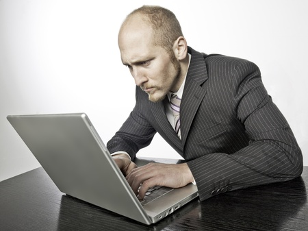 Caucasian businessman busy with his personal computer photo