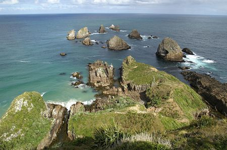 Ocean view over rugged rocks at the tip of Nugget Point, New Zealand