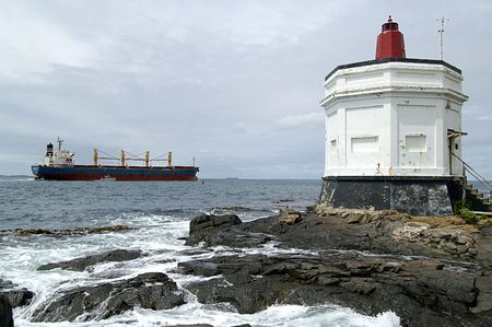 Lighthouse and container ship, Bluff, New Zealand