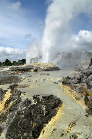 hydrothermal: Powerful eruption of a magnificent geyser with blue clouded sky in the background Stock Photo