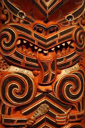 Traditional wood carving in Maori Meting House photo