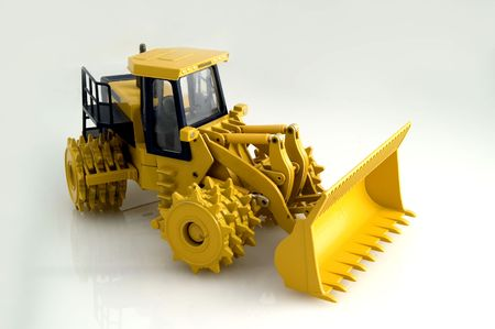 Toy model of a heavy compactor machine Stock Photo