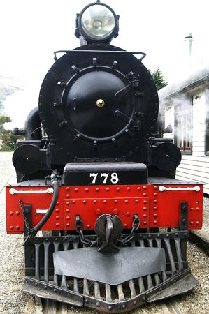 Front view of a historic steam train photo