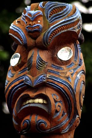 Traditional Maori face mask with cklam shells for eyes photo