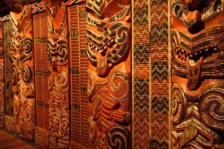 Traditional Maori Wood Carvings in Meeting House photo