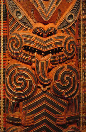 Traditional Maori Wood Carving depicting ancestors photo