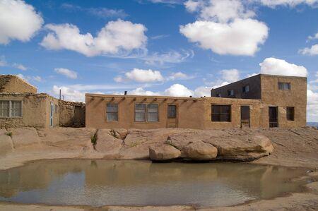 pueblo: Pueblo and a Pool of Rain Water