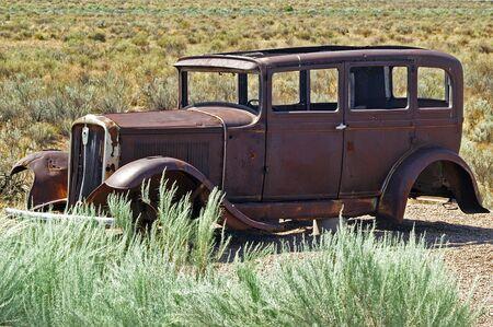 Stranded - Abandoned car in the desert photo