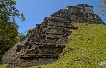 Partially excavated pyramid in Mundo Perdido (Lost World), the oldest part of Tikal. Pre-Columbian Maya Site at Tikal National Park, Guatemala, a UNESCO World Heritage Site