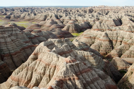 Aerial view over the colorful hills and buttes at the north-east entrance of Badlands National Park, South Dakota, USA photo