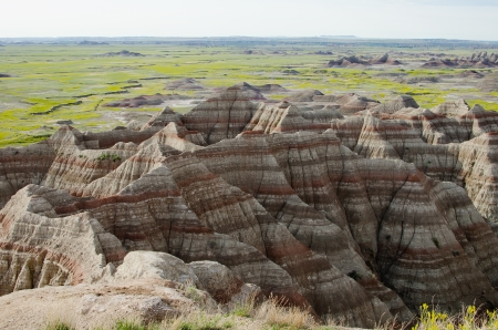 Blooming badlands seen from the Big Badlands Overlook at the northeast entrance of Badlands National Park, South Dakota, USA photo