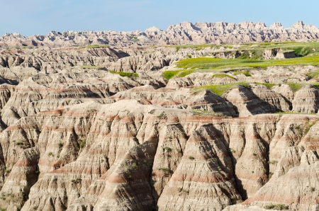 Blooming badlands as seen from the Big Badlands Overlook at the northeast entrance of Badlands National Park, South Dakota, USA Stock Photo