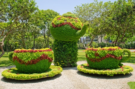 Flower arrangement forming a tea pot and two cups, Parque de la Reserva, Lima, Peru photo