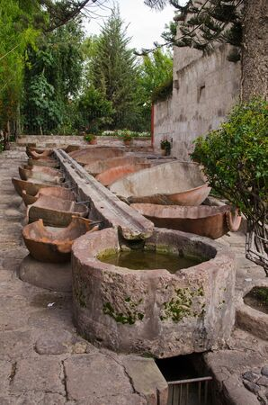 The highly sophisticated laundry  lavanderia  in Santa Catalina Monastery, Arequipa, Peru A stone duct delivers water to troughs made of cut in half amphoras  Simple but effective Stock Photo - 14830798