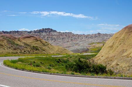 Badlands Loop Road winding down the Dillon Pass towards the Yellow Mound area  Badlands National Park, South Dakota, USA Stock Photo - 14830795