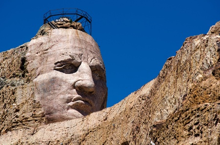The face of Crazy Horse carved out of the Thunderhead Mountain; Crazy Horse Memorial, South Dakota, USA photo