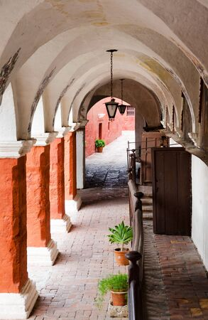 Colonnade in front of the five confessionals in Santa Catalina Monastery, Arequipa, Peru photo