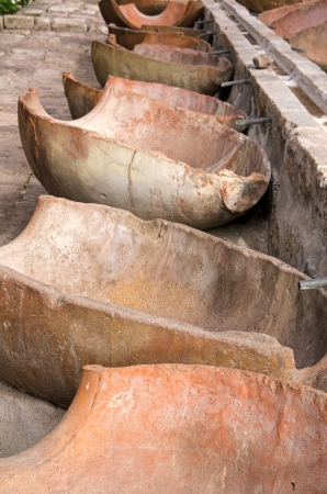 open air: The open air laundry  lavanderia  in Santa Catalina Monastery, Arequipa, Peru  An irrigation duct delivers water to troughs made of split amphorae   Stock Photo