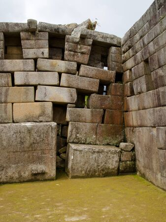 settling: The back right corner of the Main Temple at Machu Picchu shows some damage caused by the settling ground  Peru