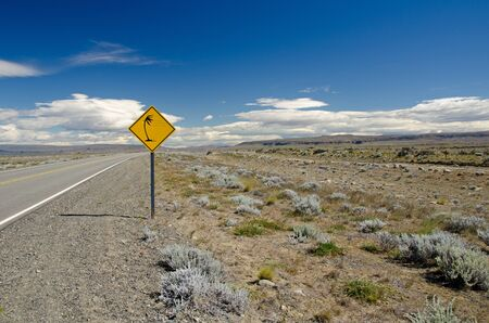 Traffic sign warning of gusty winds on route   40 near Lago Argentino in Patagonia, Argentina Stock Photo - 18289300