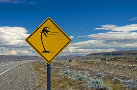 Strong winds in the pampa - A traffic sign warning of gusty winds on route   40 near Lago Argentino in Patagonia, Argentina photo