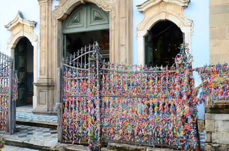 Bonfim ribbons at the entrance to Igreja Nossa Senhora do Rosario dos Pretos in Salvador do Bahia Brazil