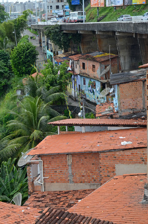 residential settlement: Favela in Salvador da Bahia Brazil. This part of the desolate coastal road is known for tourist muggings.  No surprise here.