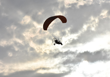 pilot light: Paragliding on sunset, silhouette of para-motor glider Stock Photo