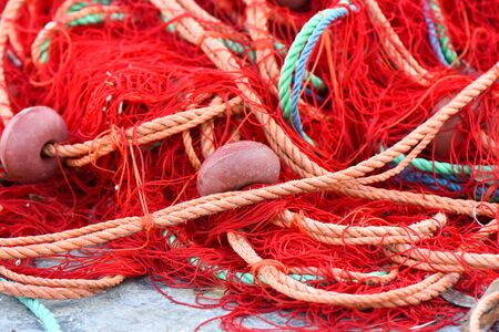 Fishing nets with red, green, orange colors.