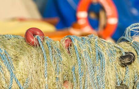 Fishing nets closeup with orange, yellow, blue colors.