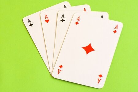 clubs diamonds: Play cards isolated on green background.