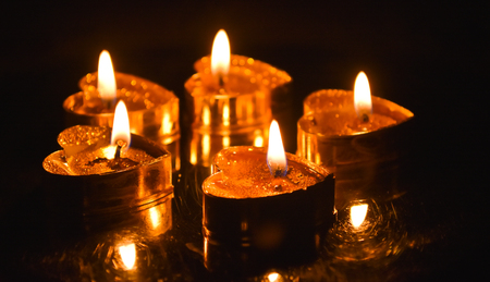 Burning candles. Candles light background. Candle flame at night. Stock Photo