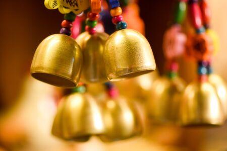 Golden Christmas bells with colorful bead Standard-Bild