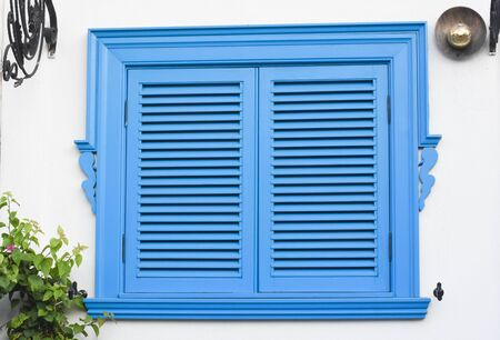 window with blue shutters 版權商用圖片