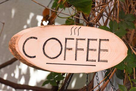 Coffee shop signboard on wood. Coffee house.
