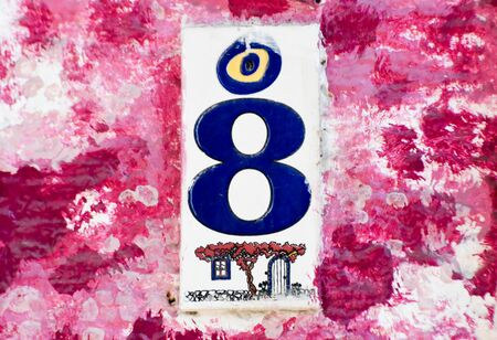A blue number eight on purple background