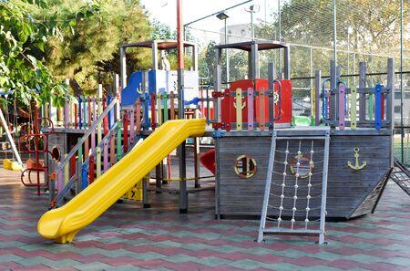 Playground in public park. Colorful playground for children. Standard-Bild