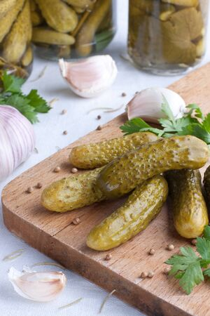 Marinated cucumbers  with garlic on wood Stock Photo - 15544122