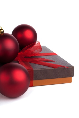 A new yer gift box with red balls Stock Photo