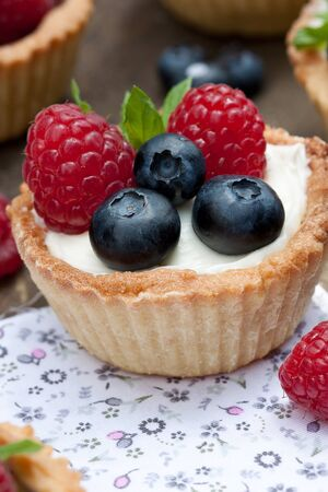 Mini tartlets with berriea and cream filling Stock Photo