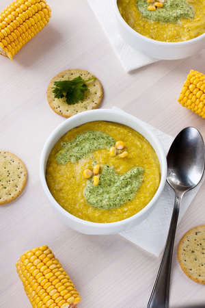 A bowl with corn soup and a spoon Stock Photo - 15541528