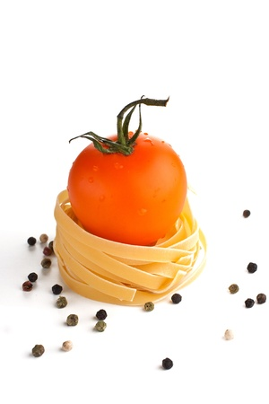 Orange tomato in pasta nest Stock Photo - 15544005