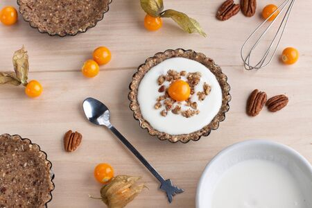 Dessert tartlets with light cream and physalis Stock Photo - 15544012