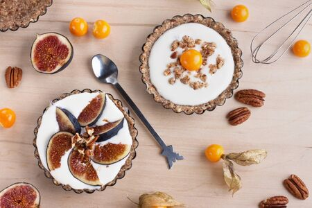 Dessert tartlets with  cream,  physalis and figs
