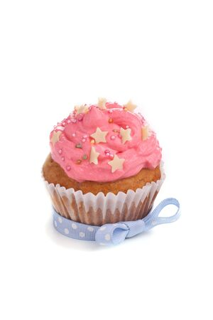 Pink cupcake with blue ribbon bow Stock Photo - 15540447
