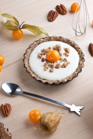 Tartlet with cream filling and  physalis