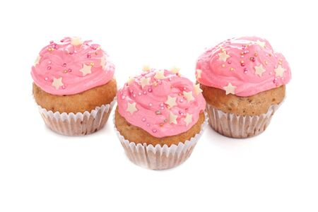 Three pink cupcakes decorated with stars Stock Photo