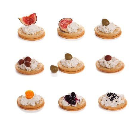 Variety of cracker canapes with cream cheese photo