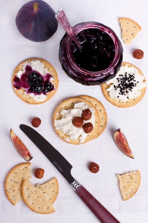 Creamed crackers with jam and nuts Stock Photo - 15568139