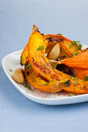 Oven roasted pumpkin slices on plate Stock Photo - 15731612